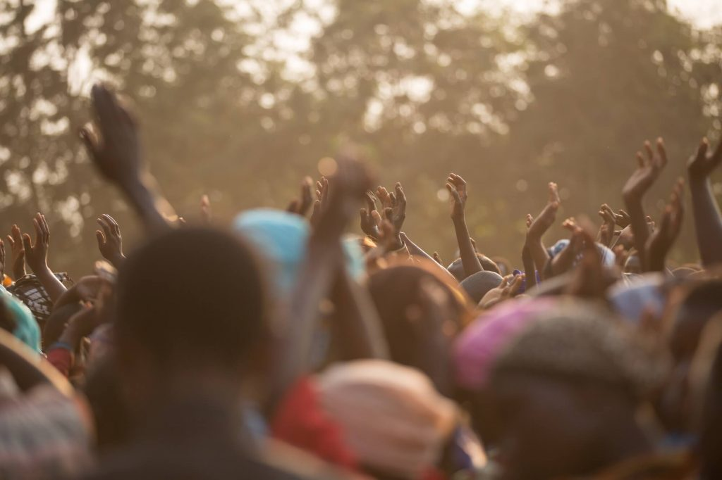 Hands Raised in Crowd, Tanzania, Avel Chuklanov, 2015
