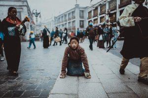 Tibetan Girl Kneeling on Road, 2017 (Journey Yang)